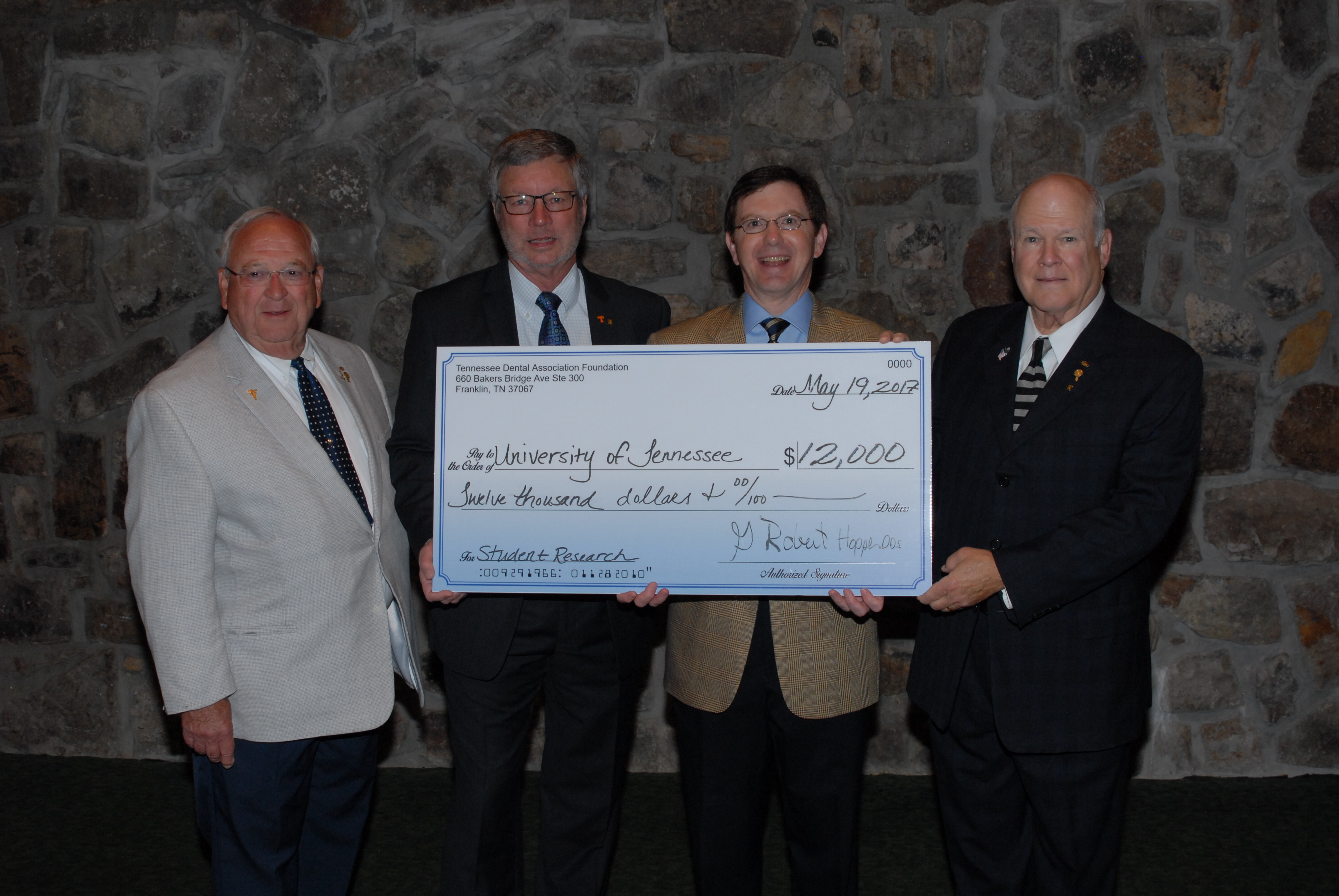 Foundation gives check for $12,000 to University of Tennessee